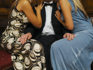 Man in Tuxedo Between Two Women © C. Lyttle/zefa/Corbis