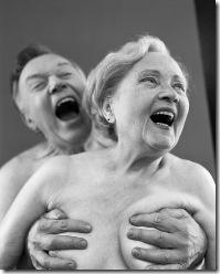 Senior Man Holding Woman's Breasts© Darama/CORBIS